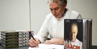 Alain Chartier signs book