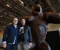 French chocolate maker Jean-Paul Hevin and Richard Orlinski pose next to their four-metre tall chocolate King-Kong in Paris