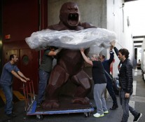 Assistants of French chocolate maker Jean-Paul Hevin unload a four-metre tall chocolate King-Kong created by Richard Orlinski in Paris