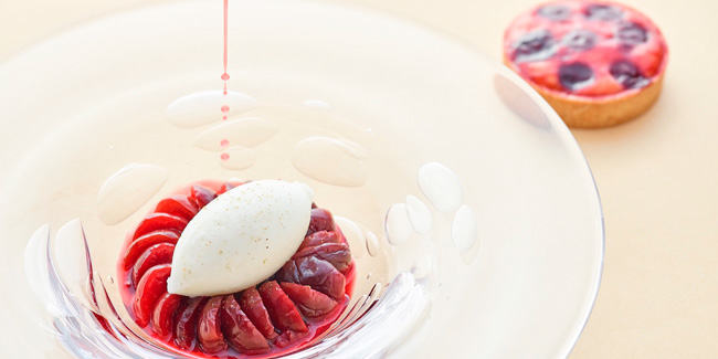Cherries poached with spices, buttermilk ice cream by Sylvain Constans