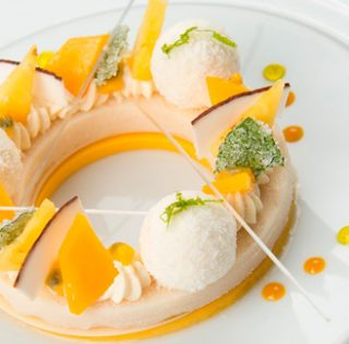 Exotic mango, coconut, passion fruit and crystallized mint leaves mojito by Patrice Ibarboure