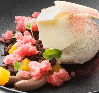 Hora del vermut with granité, chocolate crumble, ice cream, and orange jelly by Pieter de Volder