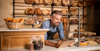 PAstry chef using tablet to sell products online