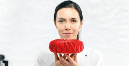 Dinara Kasko with one of her creations