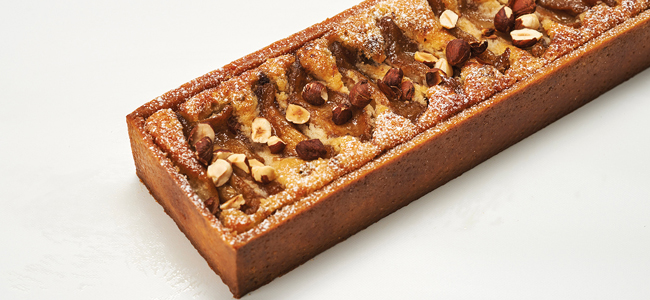 Pear tart in syrup, coconut sugar, frangipane, and hazelnuts by Belén Melamed