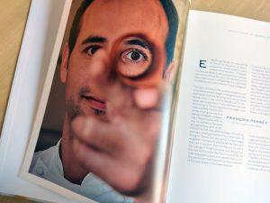 Portrait of François Perret inside his book
