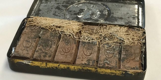 A 120-year-old chocolate box found among Australian poet Paterson's papers