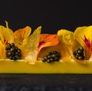 Gold beet panna cotta, caviar and fermented cashew cream dessert by Roberto Cortez